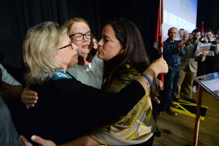 Independent candidates Jody Wilson-Raybould and Jane Philpott and Green Party Leader Elizabeth May hug following an election campaign event in Vancouver on Sept. 18, 2019.