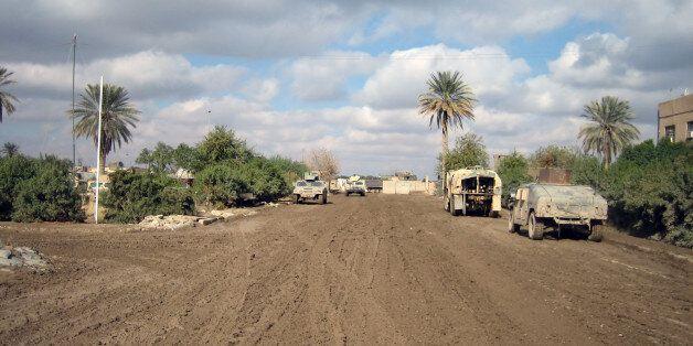 'Mud-clogged road in Ramadi,