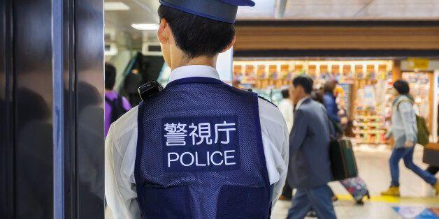 Tokyo, Japan - November 26 2013: Tokyo station provides maximun security by placing policemen in many...