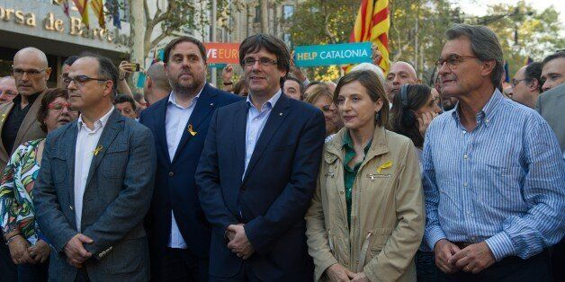 BARCELONA, SPAIN - OCTOBER 21: Catalonia's President Carles Puigdemont (C), Vice-president Oriol Junqueras...