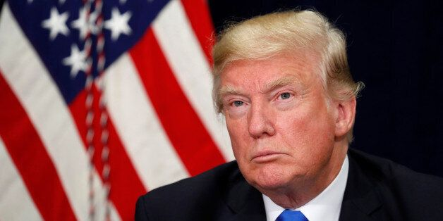U.S. President Donald Trump listens during a briefing on hurricane Harvey recovery efforts in Dallas,...
