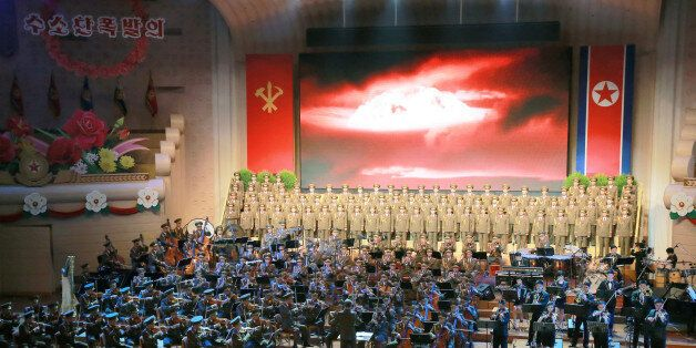 People perform for North Korean leader Kim Jong Un during a celebration for nuclear scientists and engineers...