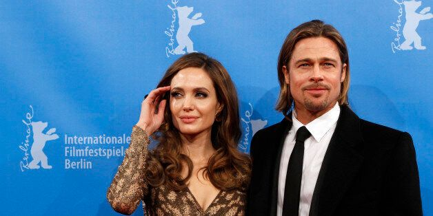 U.S. actress and director Angelina Jolie and her partner actor Brad Pitt arrive for the screening of...