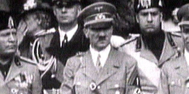 - TV PHOTO FROM 1941 - King Victor Emanuel III, (R) Adolf Hitler (C) and Benito Mussolini (L) watch fascist...
