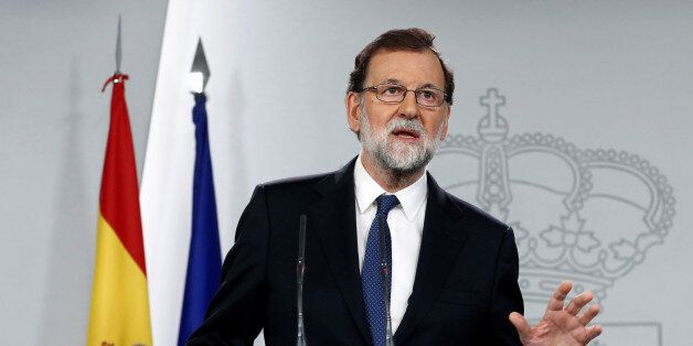 Spain's Prime Minister Mariano Rajoy speaks during a press conference at the Moncloa Palace in Madrid,...