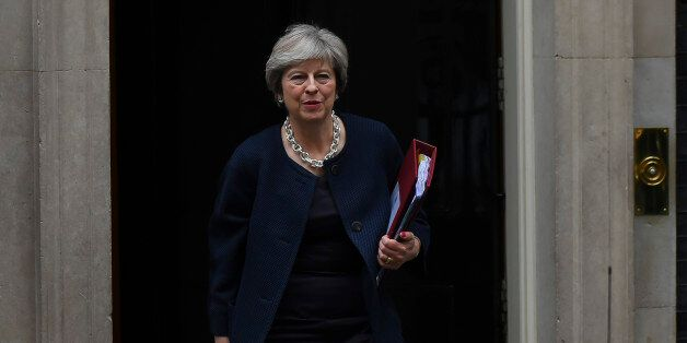 Britain's Prime Minister Theresa May leaves for the weekly Prime Minister Question (PMQ) session in the...