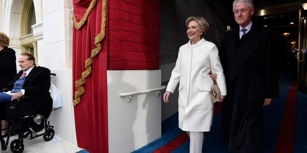Former U.S. President Bill Clinton and First Lady Hillary Clinton arrive for the Presidential Inauguration of Trump at the U.S. Capitol in Washington, D.C., U.S., January 20, 2017. REUTERS/Saul Loeb/Pool
