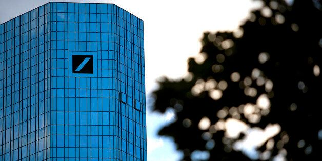 The logo for Deutsche Bank AG, continental Europe's biggest bank, is seen on the company's headquarters...