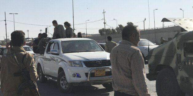 KIRKUK, IRAQ - OCTOBER 16: PKK militants, who take their guns from peshmergas, gather with their guns...