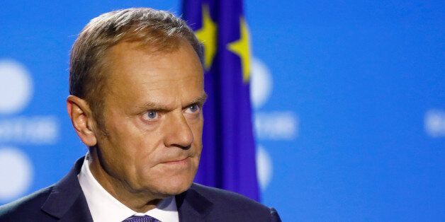 President of the European Council Donald Tusk listens at a news conference during the European Union...