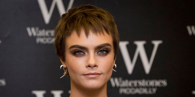 LONDON, ENGLAND - OCTOBER 04: Cara Delevingne attends the signing of her debut Young Adult novel 'Mirror,...