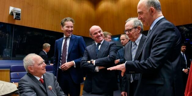 German Finance Minister Wolfgang Schaeuble (L) talks with (From 2ndL) Dutch Finance Minister and President...