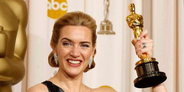 Best actress winner Kate Winslet of England poses with her Oscar for her role in