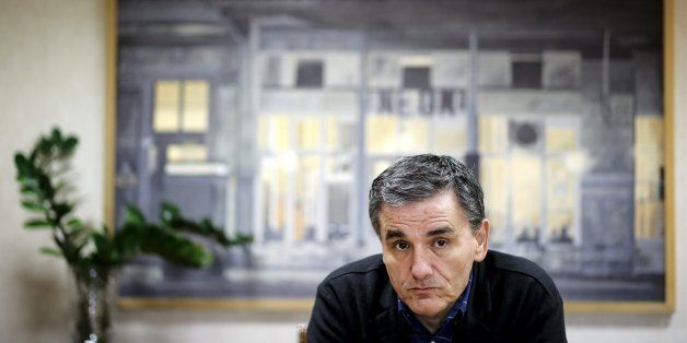 Greek Finance Minister Euclid Tsakalotos looks on during an interview with Reuters at his office in the...