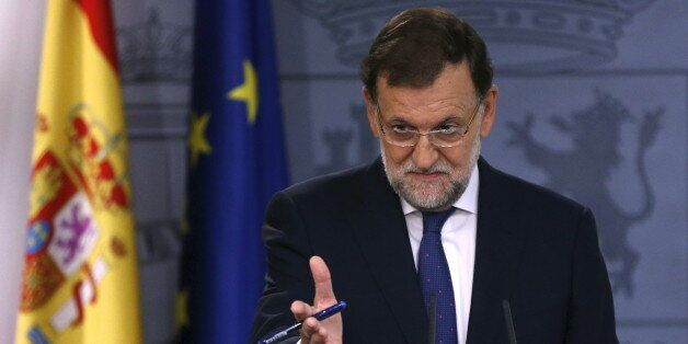 Spain's Prime Minister Mariano Rajoy gestures during a news conference at Moncloa Palace in Madrid, Spain,...