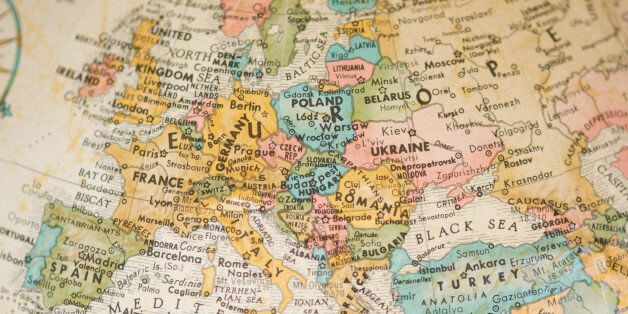 Selective focus view of vintage antique map of Europe on a faded sepia antique