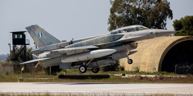 A Hellenic Air Force F-16D Block 52+ with a DB-110 reconnaissance pod, landing in front of the ex-nuclear...