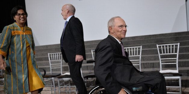 Wolfgang Schaeuble (R), Germany's finance minister, leaves the stage area the G20 Finance ministers group...