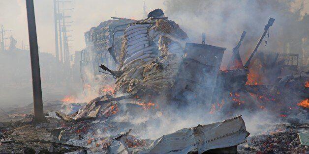 MOGADISHU, SOMALIA - OCTOBER 14 : Scene of a massive explosion is seen in the capital Mogadishu, Somalia...