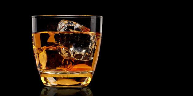 Whiskey in glass on black