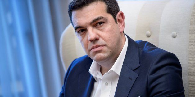 Greek Prime Minister Alexis Tsipras waits for a meeting with US President at the Maximos Mansion on November...