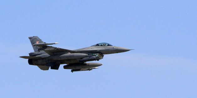 A F-16 fighting jet of the Polish Air Force flies over the air base during an exercise of NATO's Baltic...