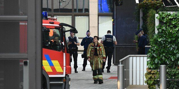 Belgian rescue personnel gather at The European Council in Brussels on October 13, 2017, after noxious...