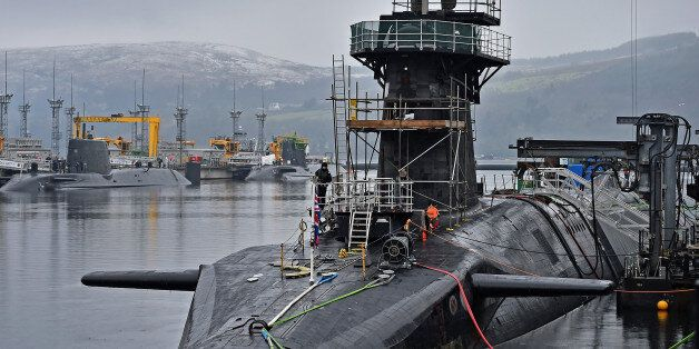 RHU, SCOTLAND - JANUARY 20: Royal Navy security personnel stand guard on HMS Vigilant at Her Majesty's...