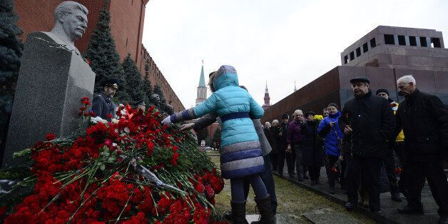 MOSCOW, RUSSIA - DECEMBER 21: Russians lay flowers at Joseph Stalin's memorial during a commemoration...