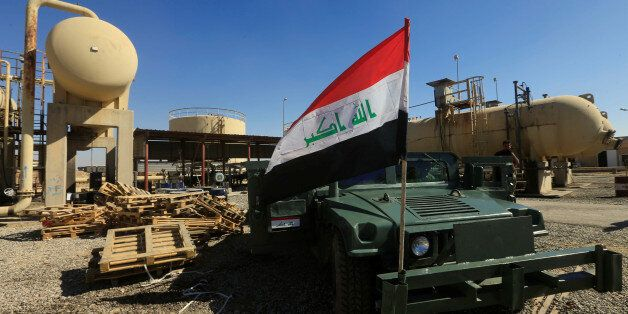 An Iraqi flag is seen on a military vehicle at an oil field in Dibis area on the outskirts of Kirkuk,...