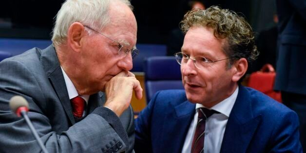 German Finance Minister Wolfgang Schaeuble (L) talks with Dutch Finance Minister and President of the...