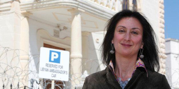 Maltese investigative journalist Daphne Caruana Galizia poses outside the Libyan Embassy in Valletta...