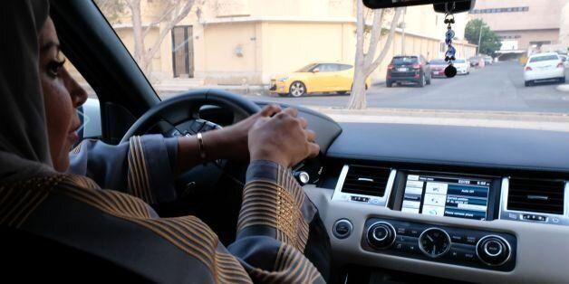 A Saudi woman drives her car along a street in the Saudi coastal city of Jeddah, on September 27, 2017....
