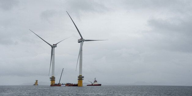 Barges position offshore floating wind turbines during assembly in the Hywind pilot park, operated by...