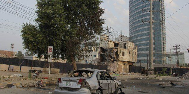 LAHORE, PAKISTAN - JULY 25 : A wreckage of a car is seen after a suicide bomb attack in Lahore, Pakistan...