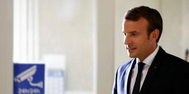 French President Emmanuel Macron arrives to attend a meeting at the Rungis international food market...