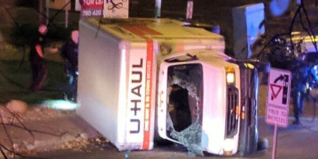 A rental truck lies on its side in Edmonton, Canada, on October 1, 2017, after a high speed chase.Canadian...