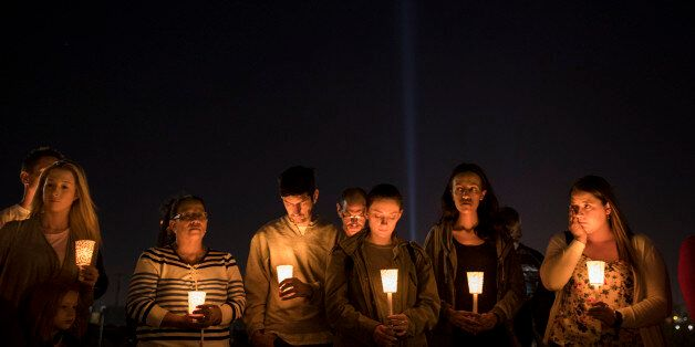 LAS VEGAS, NV - OCTOBER 3: At the corner of Sunset Road and Las Vegas Blvd., mourners attend a candlelight...