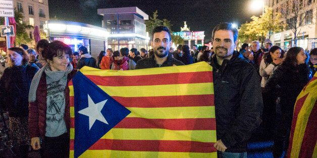 Demonstrators present the Catalonian flag during a demonstration in favor of the Catalonia's independence...