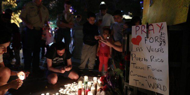 LAS VEGAS, USA - OCTOBER 3: People light candles and leave flowers during memorial for Las Vegas mass...