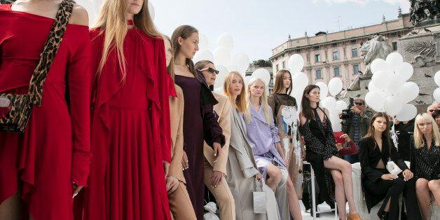 MILAN, ITALY - SEPTEMBER 25: Models performe during the Ssheena show during Milan Fashion Week Spring/Summer...