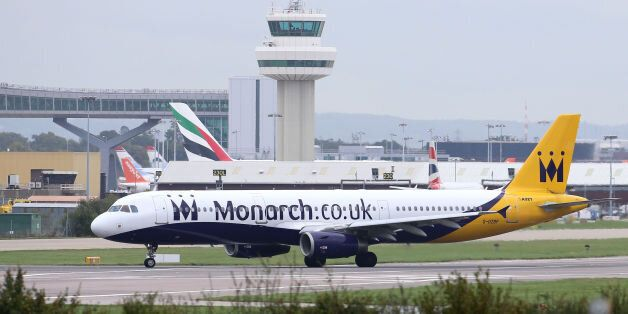 A Monarch airplane lands at Gatwick Airport, London, as the airline has been granted a 24-hour extension...
