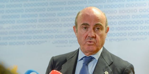 Spain's minister of Economy, Industry and Competitiveness, Luis de Guindos, speaks during a press briefing...