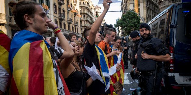 Later during the day, in front of a Police headquarter, hundreds of Catalans gather to protest against...