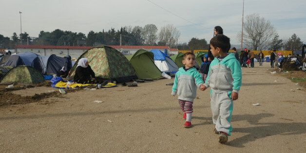 Idomeni, Greece - March 6, 2016: Refugee children are seen at the makeshift refugee camp in Idomeni,...