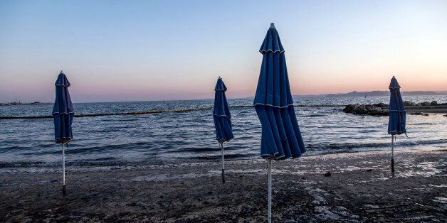An oil spill is to be seen on 14 September 2017 at a beach after a tanker sunk on 10 September 2017 by...