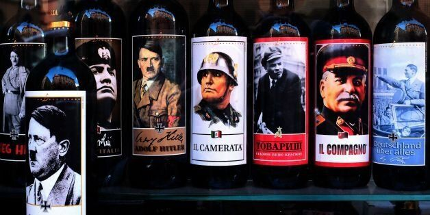 A picture taken on September 14, 2017 shows bottles of wine with pictures of Mussolini, Hitler, Lenin...