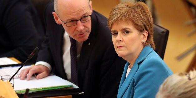 First Minister Nicola Sturgeon, and Deputy First Minister John Swinney (left), during First Minister's...
