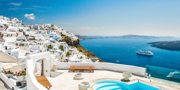 White architecture on Santorini island, Greece. Swimming pool in luxury hotel. Beautiful view on the