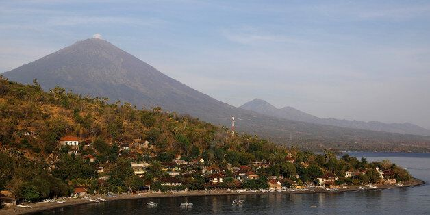 Jemeluk beach is seen some 15 km away from Mount Agung, a volcano on the highest alert level, in Amed...